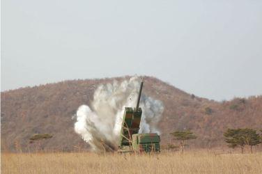 160304 - 조선의 오늘 - KIM JONG UN - 10 - 경애하는 김정은동지께서 신형대구경방사포시험사격을 지도하시였다